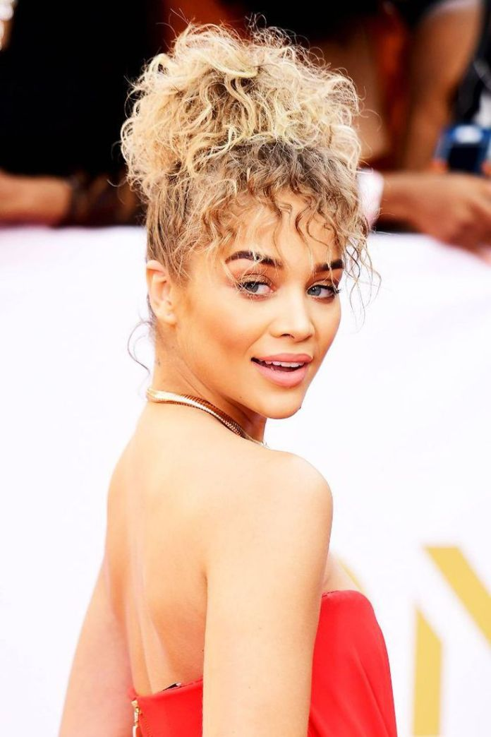 Curly-Bangs-Curly-Bun Cute Medium Length Hairstyles to Glam Up Your Look