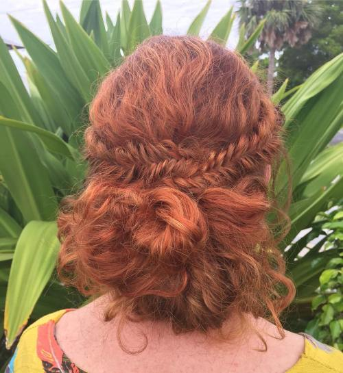Fishtail-Side-Braids-with-Loose-Bun 10 Super-Flattering Braided Hairstyles for Curly Hair of Different Types