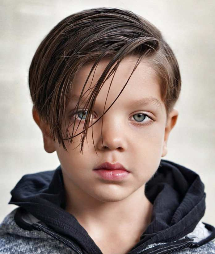 Long-Side-Parted-Hair-with-Undercut-Back Cute Haircuts for Boys for Charming Look