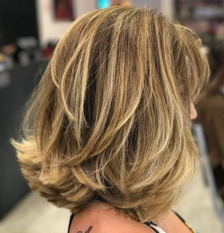 Medium-Layers-and-Flipped-Ends-1 14 Sensational Medium Length Haircuts for Thick Hair