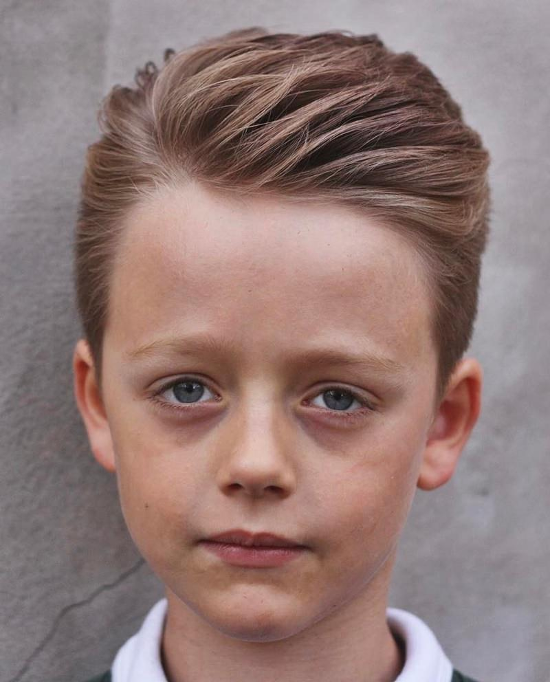 Slicked-Back-Sideways-Hair Cute Haircuts for Boys for Charming Look
