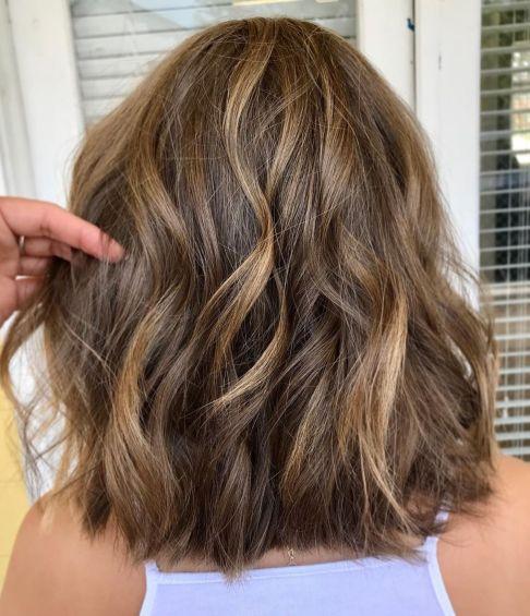 Thick-Shaggy-Golden-Brown-Lob-1 14 Sensational Medium Length Haircuts for Thick Hair