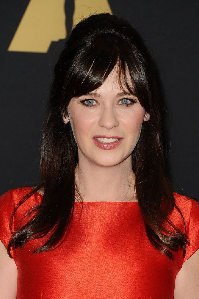 Voluminous-Bangs-With-a-Side-Part 14 Best Hairstyles With Bangs to Inspire Your Next Cut