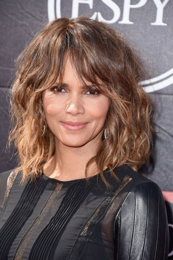 Wavy-and-Feathery-Bangs 14 Best Hairstyles With Bangs to Inspire Your Next Cut