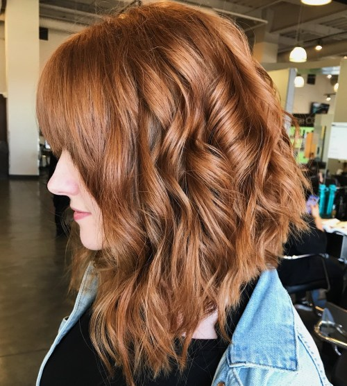 Curly-Lob-with-Front-Bangs 15 Hottest bobs hairstyles to try in 2020