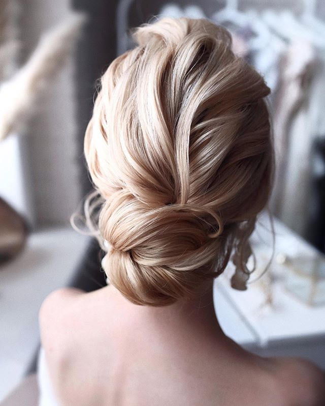Plain-Bun-Hairstyle Ultra Modern Wedding Hairstyles 2020