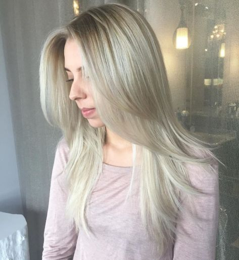Sleek-Hairstyle-with-Long-Feathered-Layers 12 Stunning Hairstyles for Long Fine Hair