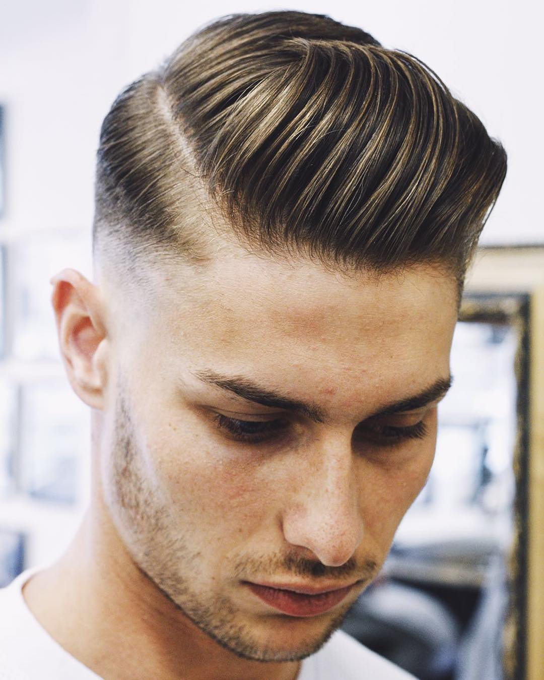 Slick-Hair-with-Side-Part-and-Undercut Modern Hairstyles for Men to Look Awesome