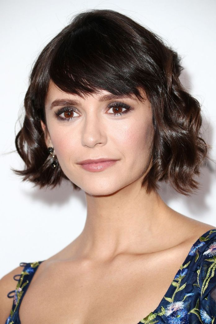 thick-layer-of-piece-y-feathered-bangs 15 Stunning Bob Cuts That'll Convince You To Go Short