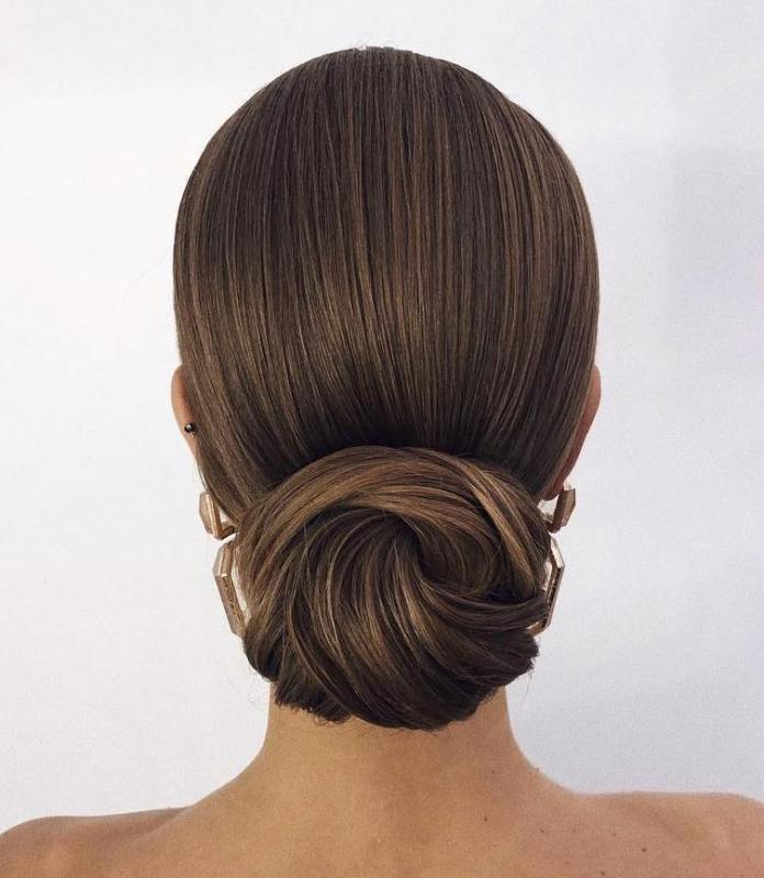 Brushed-back-sleek-knotted-hair 20 Eye-catching Updo Hairstyles To Make Your Day