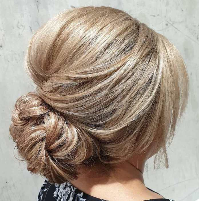 Bun-with-Bangs 15 Beautiful Hairstyles for Mother of The Bride That's Easy To Put Together