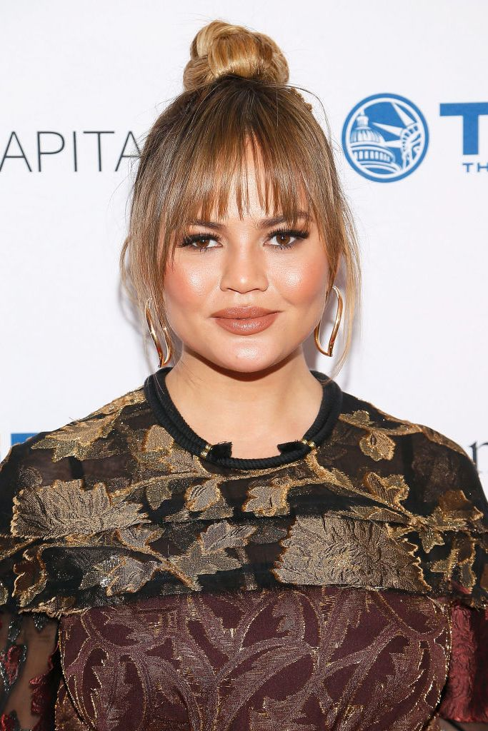 Choppy-Bangs-with-Top-Knot 25 Stupendous Hairstyles for Round Faces