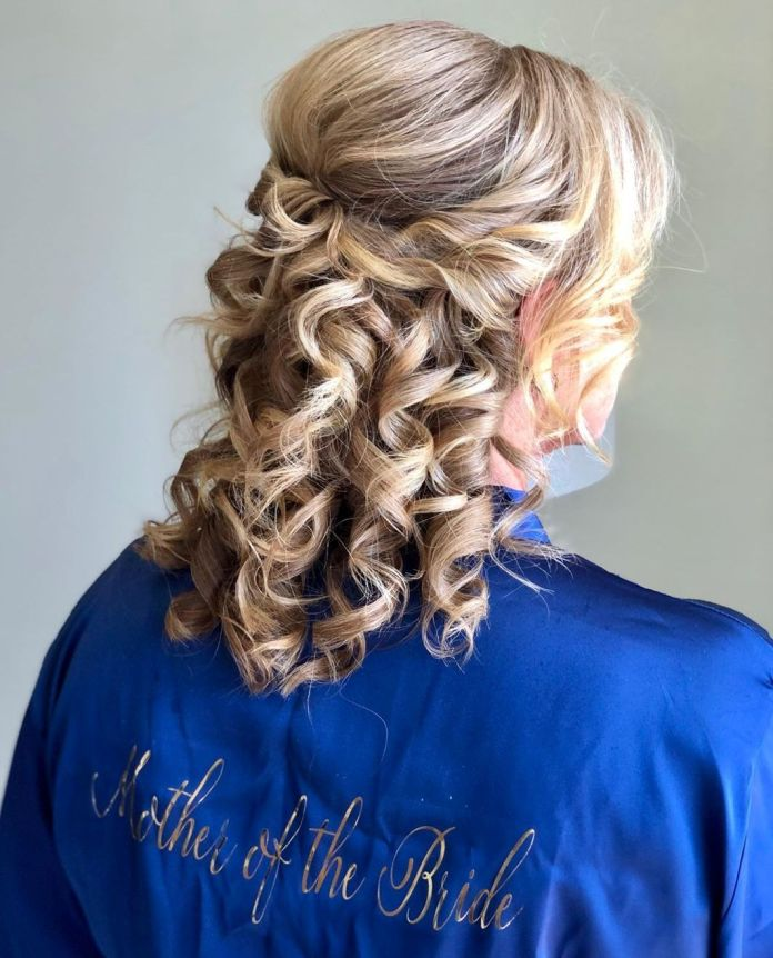 Curly-Half-Updo 15 Beautiful Hairstyles for Mother of The Bride That's Easy To Put Together