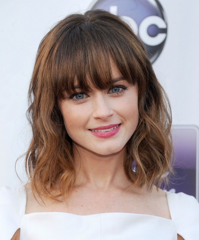 Cute-and-Wavy-Fringes 15 Hairstyles with Bangs for an Ultimate Gorgeous Look
