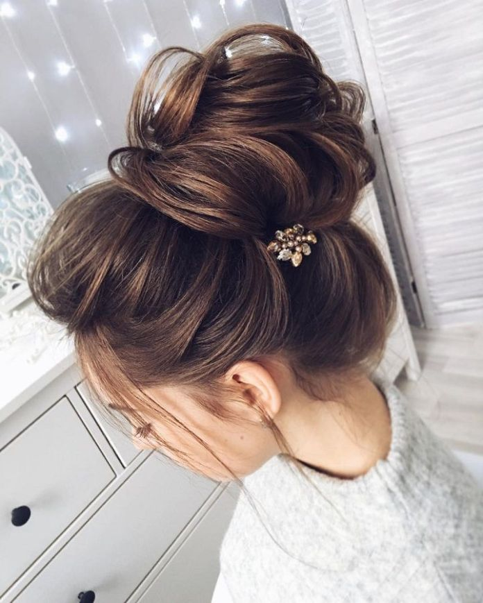 Floral-Layered-Bun-Accessorized-with-Hair-Clip Messy Bun Hairstyle is the New Style to Enhance Your Look