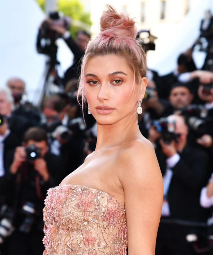 High-Messy-Bun-with-Pink-and-Brown-Balayage Messy Bun Hairstyle is the New Style to Enhance Your Look