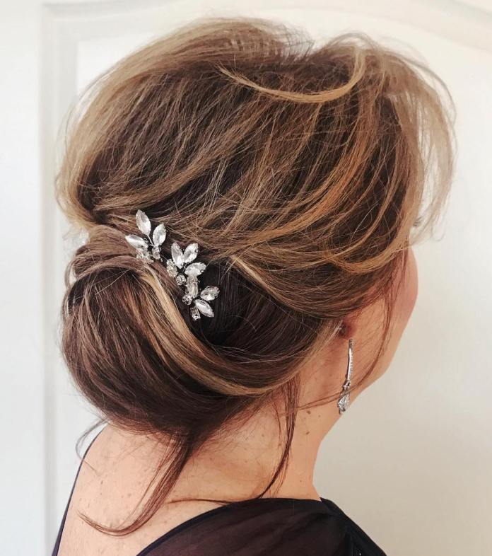 Low-Textured-Updo 15 Beautiful Hairstyles for Mother of The Bride That's Easy To Put Together