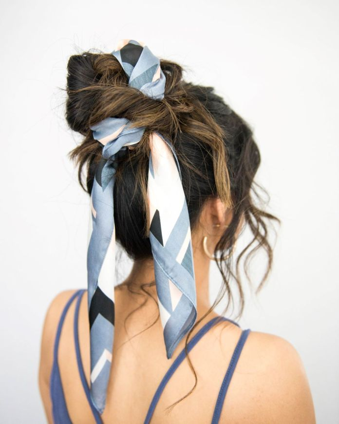 Messy-Bun-Tied-Up-with-Ribbon Messy Bun Hairstyle is the New Style to Enhance Your Look