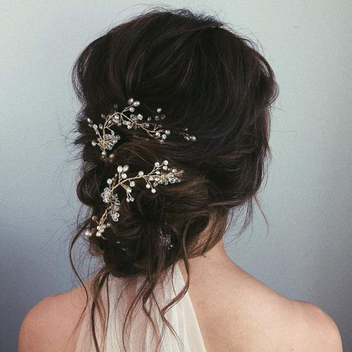 Messy-Low-Bun-Accessorized-with-Hair-Accessory Messy Bun Hairstyle is the New Style to Enhance Your Look