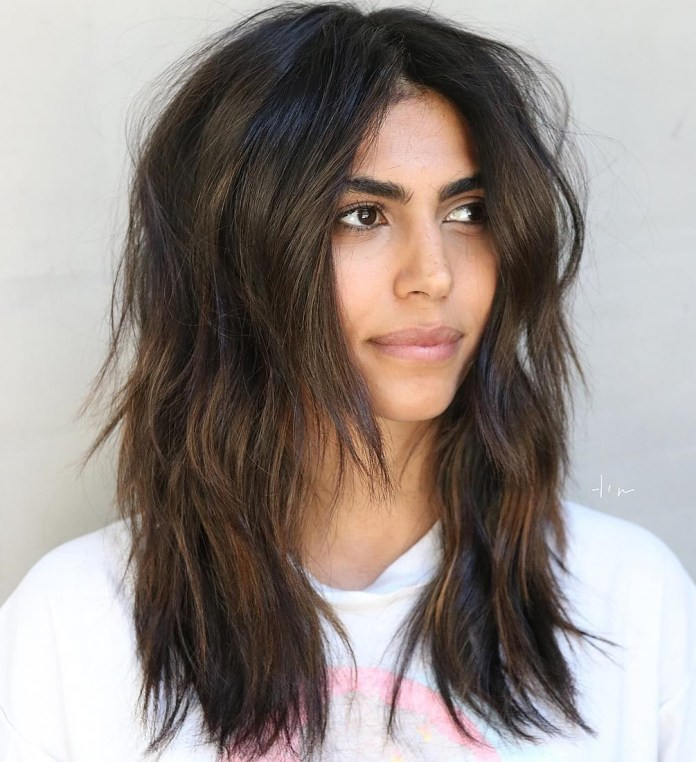 Slightly-wavy-and-heavily-textured 12 Chic Hairstyles For Women With Long Faces
