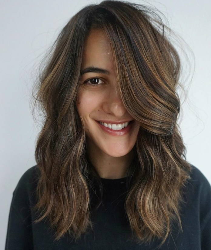 laid-back-waves-for-thick-hair 12 Chic Hairstyles For Women With Long Faces