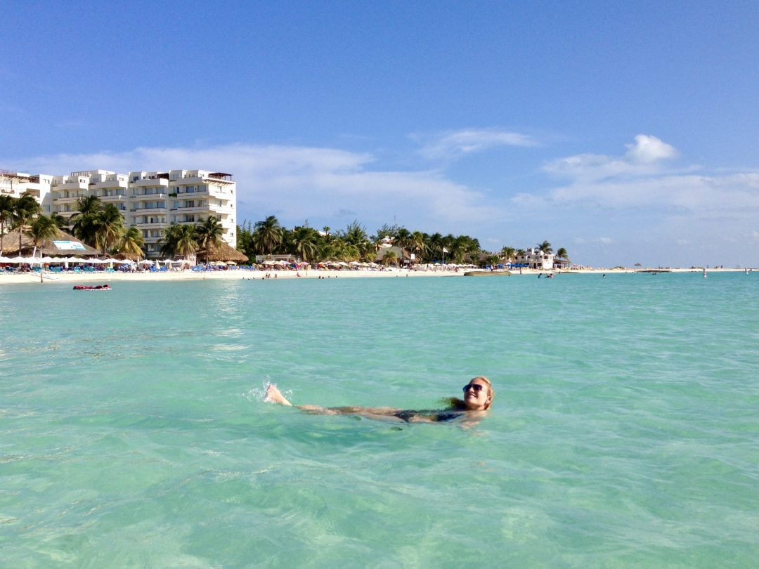 Swimming at crystal clear waters of Playa Norte in Isla Mujeres, Mexico