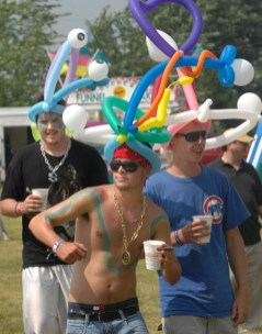 Troy Weikle, front, Ryan Moran, center, and Derek Gaald, back, all from Bloomington, wear their balloon hats and kick back with a cup of beer while they enjoy the seventh annual Nothin' But the Blues Festival at Tri-lakes in Bloomington Saturday afternoon (July 19, 2008). (Pantagraph/B Mosher)