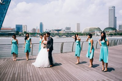 Bridesmaid as backdrop.