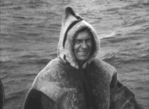 Floyd Bennett models the sealskin flight suit the crew obtained in Labrador. Bennett accompanied Byrd on his 1926 flight over the North Pole. He would die just a few years later, while on a flight to rescue stranded pilots.