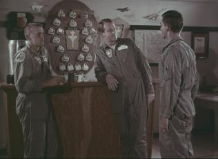 Lt. Blake (R) approaches Capt. Kendall.