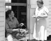 16-G-130-S-6323: Mrs. Blalock and son Carlton figuring up on the egg account. Carlton sells his eggs at the HD market. N.C. May 1940