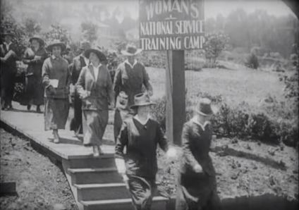Women arrive at the training camp.
