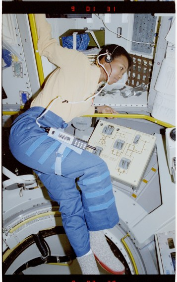 """Photographic documentation of Mission Specialist (MS) Mae Jemison near Rack 1 in Spacelab-Japan (SL-J)"" - Mae Jemison is the first African-American female astronaut. In 1992, she flew into space aboard the Endeavour, becoming the first African-American woman in space."