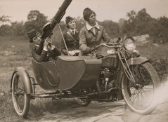 """Women's Machine Gun Squad Police Reserves, New York City - Praciticing with Lewis Machine gun, which is to be sent to the front....Capt. Elise Reniger manning the gun, Miss Helen Striffer on the rear seat, and Mrs. Ivan Farasoff driving."" Date taken: August 1918 (Local ID: 165-WW-143B-23)"