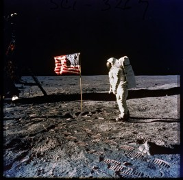 306-AP-A11F-40-5875: Photograph of Astronaut Edwin E. (Buzz) Aldrin, Jr. Posing on the Moon Next to the U.S. Flag