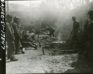 """(Local Identifier: 111-SC-366011) """"Greek troops attached to the First Cavalry Division, roast lambs in barbecue pits during Easter celebration."""""""