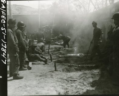 "(Local Identifier: 111-SC-366011) ""Greek troops attached to the First Cavalry Division, roast lambs in barbecue pits during Easter celebration."""