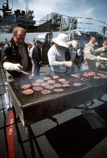 "(Local Identifier: 330-CFD-DN-ST-92-01291) ""Crew members prepare hamburgers and hot dogs aboard the destroyer USS O'BANNON (DD-987) in preparation for a cookout aboard the vessel. The O'BANNON is underway during exercise Unitas XXXII, an annual, combined exercise involving the U.S. Navy and the naval forces of nine South American countries."""
