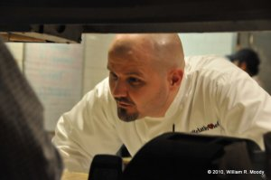 Chef Dan Moody showing is cooking skills to hungry learners