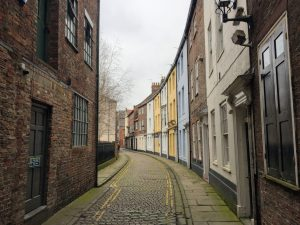 It is never dull in Hull | Loking at different coloured buildings following a curved street