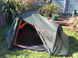 Pitched tent ready for sweeping and airing