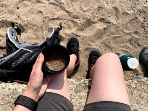 Looking down at my legs and cup of tea by lytham st annes beach and dunes