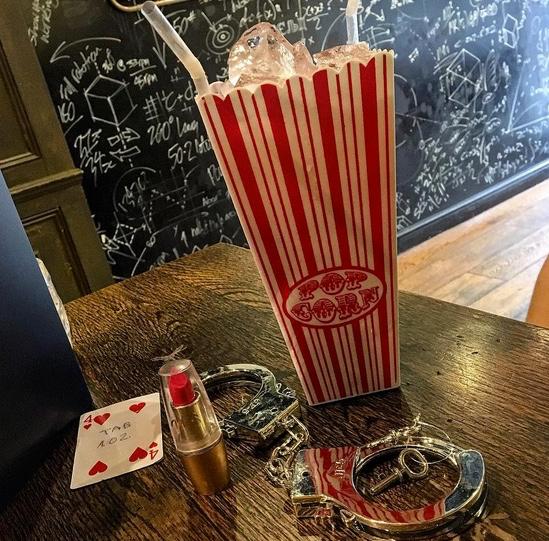 Poppy Horror | Adventure Bar Convent Garden, London | Serves 5-8 | £22-59 Eristoff vodka, blackcurrant liqueur, fresh lemon juice, sugar, prosecco, lipstick, handcuffs Photo credit: @soph_marie94