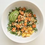 Citrus Spring Bowl bursts with flavor from roasted sweet potatoes combined with creamy avocado and a soft bite from chopped almonds, all tied together with pearled couscous and a bright dressing