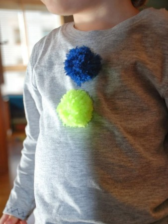 clothes with pompoms for children
