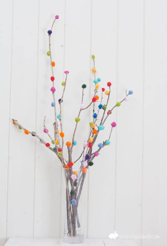 Branches decorated with pompoms