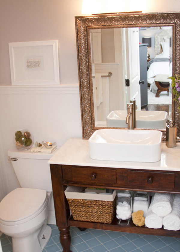 A small bathroom with the mirror on the countertop