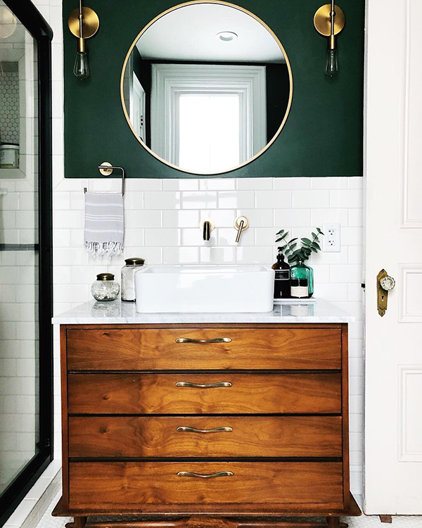 A small bathroom in green and gold