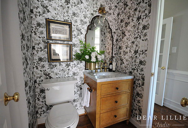 A small bathroom lined with wallpaper