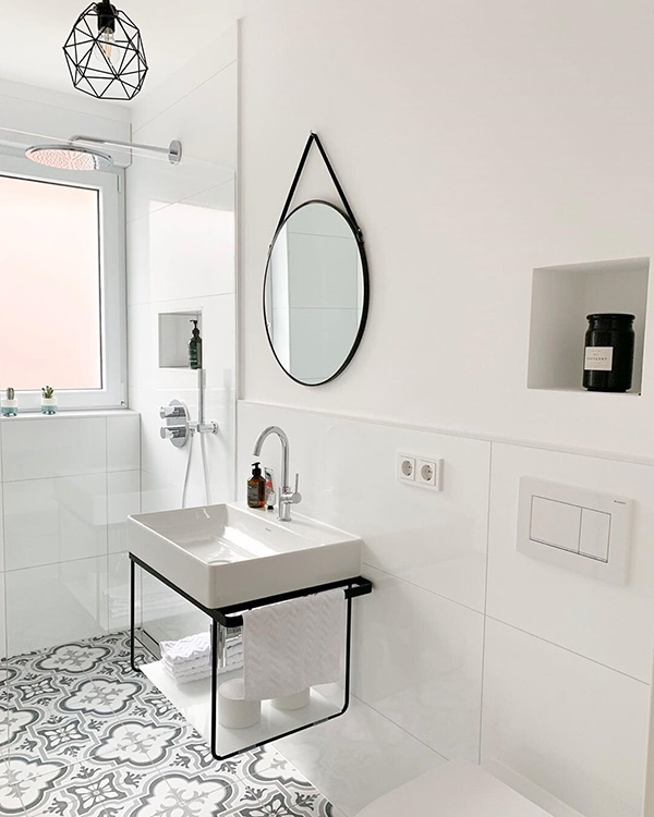 A small and modern minimalist black and white bathroom